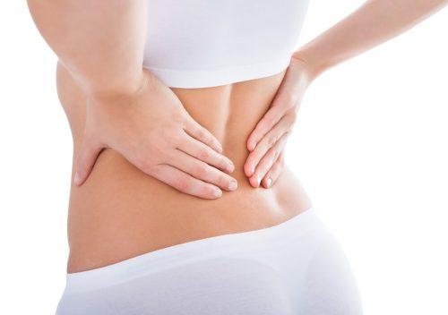 Đau lưng là một trong những triệu chứng báo hiệu mang thai